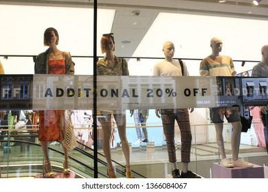Munich, Bavaria/Germany, 04.09.2019: Display dummies of Topshop seem to watch the customers on the street. Shop window decoration for mid season sale period.