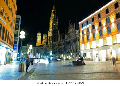 Munich, Bavaria/Germany- 05/21/2018: A few visitors remain in Munich's Marienplatz as nightfall arrives.