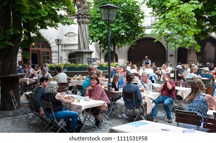 Munich, Bavaria/Germany- 05/22/2018:  Visitors to Munich take advantage of a warm spring day to have drinks in a biergarten.