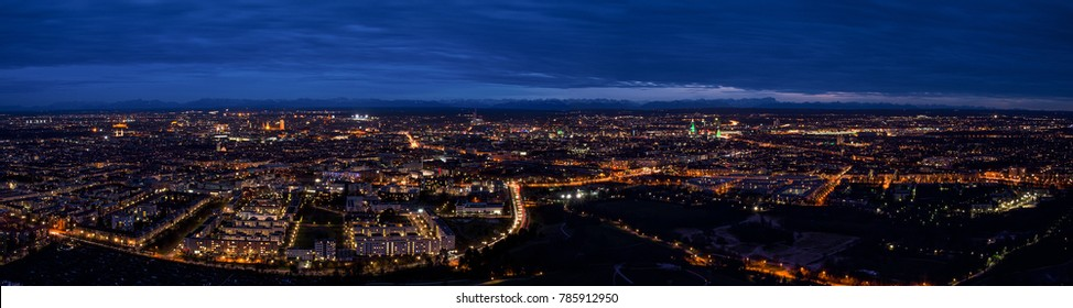 Munich center cityscape night panoramic aerial view. Skyline panorama captured from height of lookout viewing platform on tv-tower.