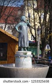 Munich - Dec 08, 2018: Fountains celebrating famous Bavarian folk artists can be found at the Viktualienmarkt. This fountain commemorates Liesl Karlstadt.