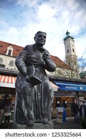 Munich - Dec 08, 2018: Fountains celebrating famous Bavarian folk artists can be found at the Viktualienmarkt. This fountain commemorates folk actor Ilse Aulinger.