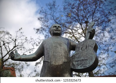 Munich - Dec 08, 2018: Fountains celebrating famous Bavarian folk artists can be found at the Viktualienmarkt. Roider Jackl was a folk singer in the 1950's.