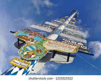 Munich - Dec 08, 2018: This maypole at the Viktualienmarkt commemorates the purity law, that German beer brewers adhere to.