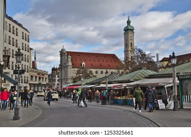 Munich - Dec 08, 2018: View over the Viktualienmarkt, where fresh products are on sale. The Heiliggeist Church is in the background.