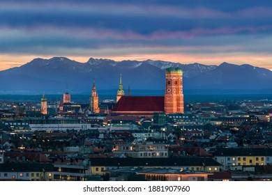 Munich at dusk - Mountains of German Alps behind Frauenkirche