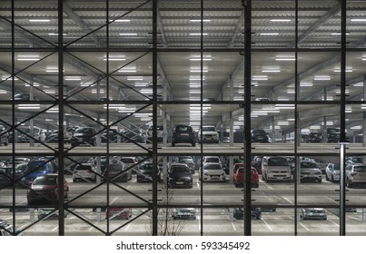 MUNICH, FEBRUARY 2017 : Multi level open parking with cars at night . Example of modern architecture in Europe.