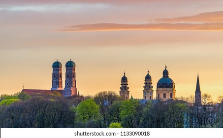 Munich Frauenkirche during beautiful sunset in summer with a fantastic sky