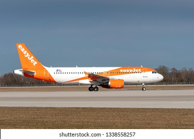 Munich, Germany - 04. March 2019 : easyJet Airbus A320-214 with the aircraft registration OE-ICK is taxiing for take of on the northern runway 26R of Munich Airport MUC EDDM