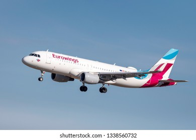 Munich, Germany - 04. March 2019 : Eurowings Airbus A320-214 with the aircraft registration OE-IEW in the approach to the northern runway of the Munich airport MUC EDDM