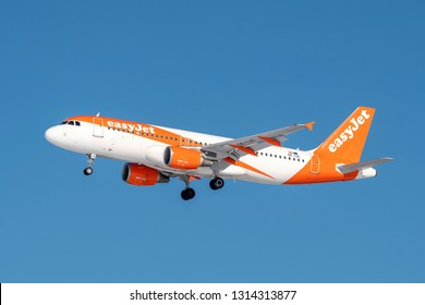 Munich, Germany - 08. February 2019 : easyJet Europe Airbus A320-214 with the aircraft registration OE-IJO in the approach to the northern runway of the Munich airport MUC EDDM