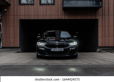 Munich, Germany 12 February 2020, BMW G15 (two-door coupe version) 850i Xdrive M performance Concept M8 Gran Coupé 2020 Black shadow line carbon edition standing at the parking. Close up front view.