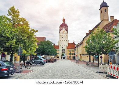 Munich, Germany - 14 JUNE 2018: City road with main clock tower on background in Erding City, Munich