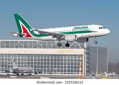Munich, Germany - 15. February 2019 : Alitalia Airbus A319-111 with the aircraft registration EI-IMV in the approach to the southern runway of the Munich airport MUC EDDM