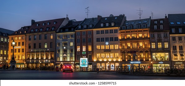 Munich, Germany - 19 October 2018: Spatenhaus and other old houses at Max-Joseph-Platz at night