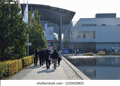 Munich, Germany - 26.8.2018: Visitors on the way to the congress center Munich