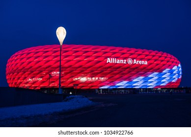 MUNICH, GERMANY - 27 February 2018: Allianz Arena special illumination for FC Bayern Munich 118th Birthday with bright red and white-and-blue diamonds
