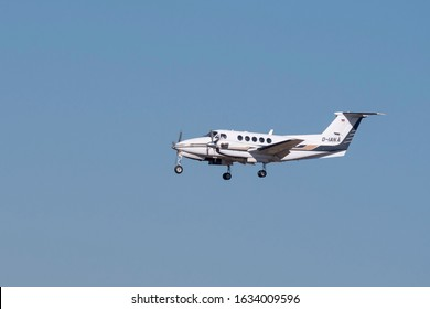Munich, Germany - 27. February 2019 : Dix Aviation Beechcraft B200 Super King Air with the aircraft registration D-IANA in the approach to the northern runway 26R of the Munich Airport MUC EDDM