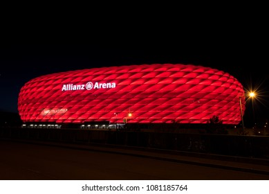 MUNICH, GERMANY - 29 April 2018: Allianz Arena, the football stadium of FC Bayern, illuminated in red at night