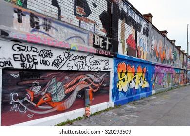 MUNICH, GERMANY - 4 AUGUST 2015: MUNICH, GERMANY - 4 AUGUST 2015: Vibrant urban art at the famous legal graffiti spot - Tumblingerstrasse in Munich, Bavaria.