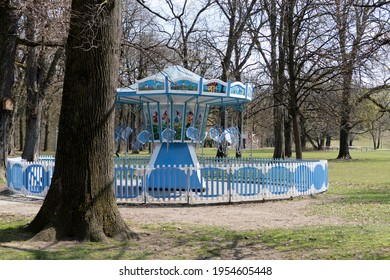 Munich, Germany - April, 11th, 2021: Closed carousel in Hirschgarten park in Munich, Germany