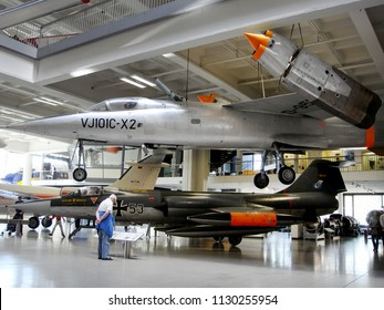 Munich, Germany - April 13, 2009. A VJ-101 (Foreground) jet fighter and an F-104 Starfighter (Background) inside the Deutsches Museum.