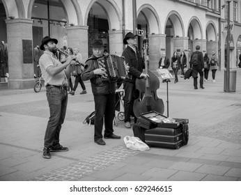 Munich, Germany - APRIL 2, 2017:  musicians playing on the street in the Marienplatz, Germany
