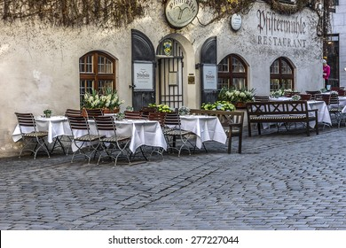 MUNICH, GERMANY - APRIL 21, 2015: Traditional Bavarian restaurant outdoor. Munich is the capital and largest city of the German state of Bavaria.