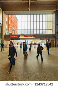 MUNICH, GERMANY - APRIL 30, 2013 : Interior of Munich Main station also known as München Hauptbahnhof when passengers pass by in Munich.