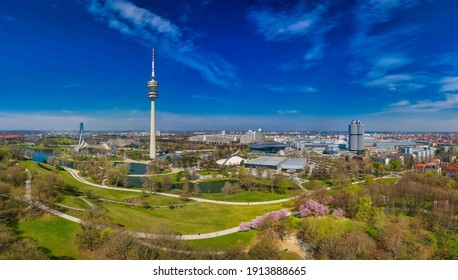 MUNICH, GERMANY - April 3th, 2019: The Olympiapark in panoramic full view - Munich, Germany, tourism hotspot of the bavarian capital at a beautiful day in spring.