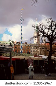 MUNICH, GERMANY - APRIL 5, 2018 - Mixed spring weather, blue sky and dark clouds over Viktualienmarkt in Munich center, touristic attraction and market for gourmets