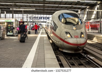 MUNICH, GERMANY - AUG 26, 2017: Deutsche Bahn ICE train stopping at platform of Munich Hauptbahnhof (Central Station). It is widely uses in Germany and International traffic in Europe