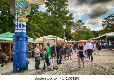 MUNICH, GERMANY -  AUGUST 16, 2019 local buyers and tourists mingle together at the Viktualienmarkt, open air market of food and delicacy in Munich city center.