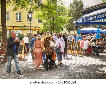 MUNICH, GERMANY -  AUGUST 16, 2019 local buyers and tourists mingle together at the Viktualienmarkt, beer garden and open air market of food and delicacy in Munich city center.