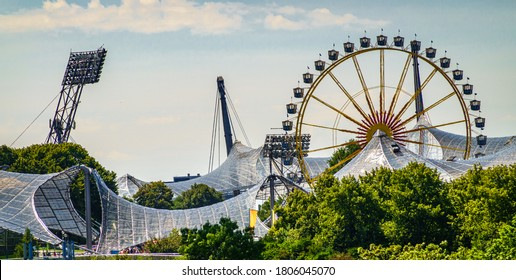 "Munich, Germany - August 16: Carousel and people during the ""summer in the city"" (sommer in der stadt) event in Munich Olympiapark on August 16, 2020"