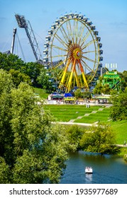 """Munich, Germany - August 16: Carousel and people during the """"summer in the city"""" (sommer in der stadt) event in Munich Olympiapark on August 16, 2020"""