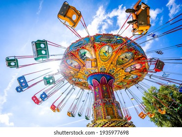 """Munich, Germany - August 16: Carousel and people during the """"summer in the city"""" (sommer in der stadt) event in Munich on August 16, 2020"""