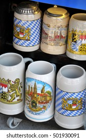 MUNICH, GERMANY - AUGUST 17, 2011: Typical beer mugs, decorated with regional motifs, in a tent city