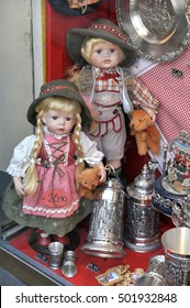 MUNICH, GERMANY - AUGUST 17, 2011: Dolls and other souvenir items in the store window