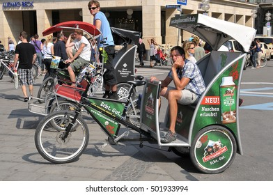 MUNICH, GERMANY - AUGUST 17, 2011: Several rickshaw drivers, waiting for customers in the Marienplatz
