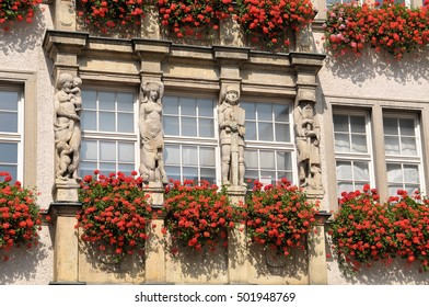 MUNICH, GERMANY - AUGUST 17, 2011: Detail of the sculptures that decorate the building Hirmer, in commercial city center