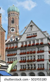 MUNICH, GERMANY - AUGUST 17, 2011: Frau church bell tower and shopping center in the city center