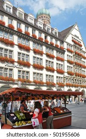 MUNICH, GERMANY - AUGUST 17, 2011: Commercial building and street stalls in the city center
