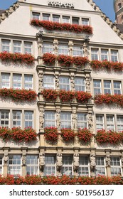 MUNICH, GERMANY - AUGUST 17, 2011: Windows decorated with flowers, on the facade of an important commercial building in the city
