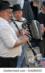 MUNICH, GERMANY - AUGUST 17, 2011: Jewish musicians playing in a shopping street in the city
