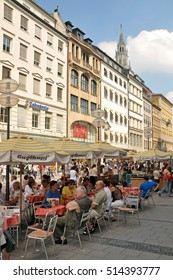 MUNICH, GERMANY - AUGUST 17, 2011: People in the terraces of the bars in the city center