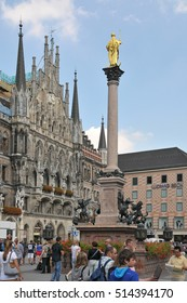 MUNICH, GERMANY - AUGUST 17, 2011: Monument to the Virgin and facade of the town hall