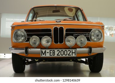 MUNICH, GERMANY - AUGUST 17, 2013:   BMW 2002 TI classic German luxury 1960s New Class car in the BMW Museum. The BMW 02 Series is a range of compact executive cars produced by BMW from 1966 till 1977