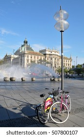 MUNICH, GERMANY - AUGUST 18, 2012: Bicycle parked opposite the source of Karlsplatz
