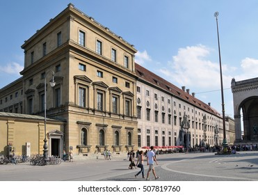 MUNICH, GERMANY - AUGUST 18, 2012: Outside of old mansions in the Odeon Square